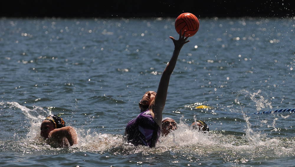 Willamette Valley Water Polo's Alexandera Glenn attemps to break up a pass during the Nike Open Water water polo tournament at Foster Lake near Sweet Home.  Photo by Mark Ylen
