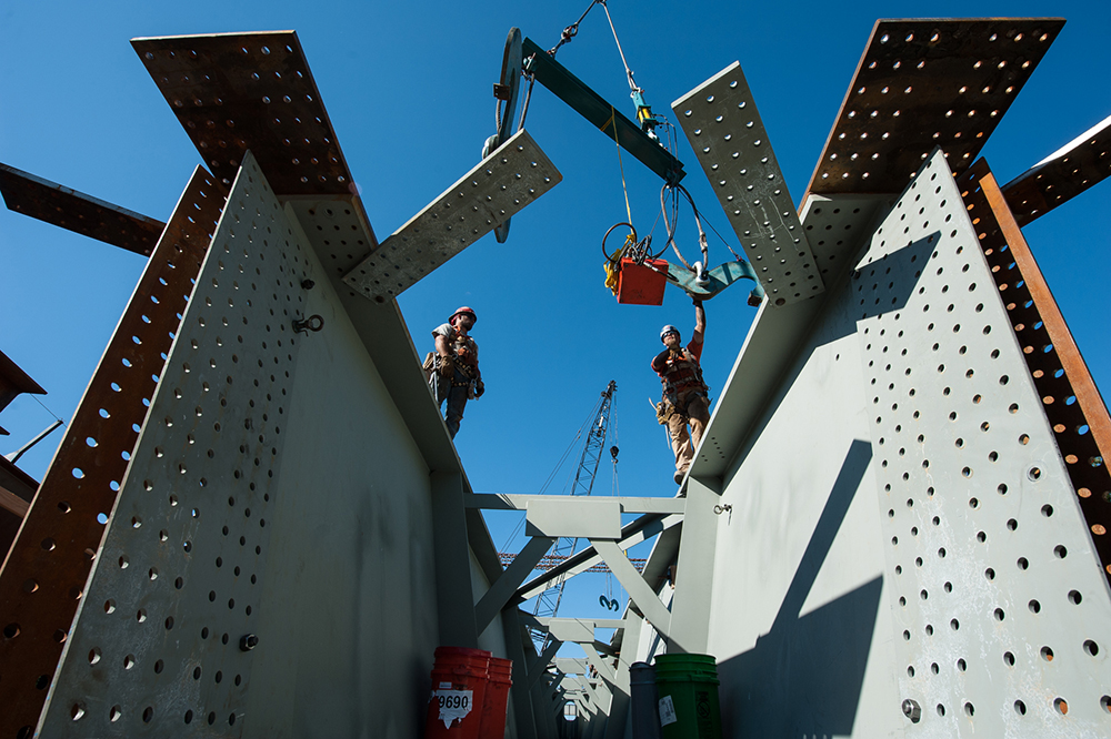 Riggers preparing to crane in a tub girder from a truck to the light rail bridge over Kellogg lake in Milwaukie, Oregon. Photo by Mark Gamba