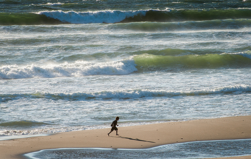 Young boy runs along the beach at Road's End State Recreation Site in Lincoln City.  Photo by Rich Iwasaki