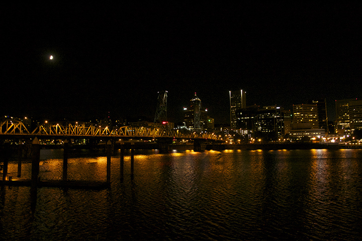 Moon, Hawthorne Bridge and Portland cityscape from the Vera Katz Esplanade under the Hawthrone Bridge ramp. Photo by Sue Zalokar