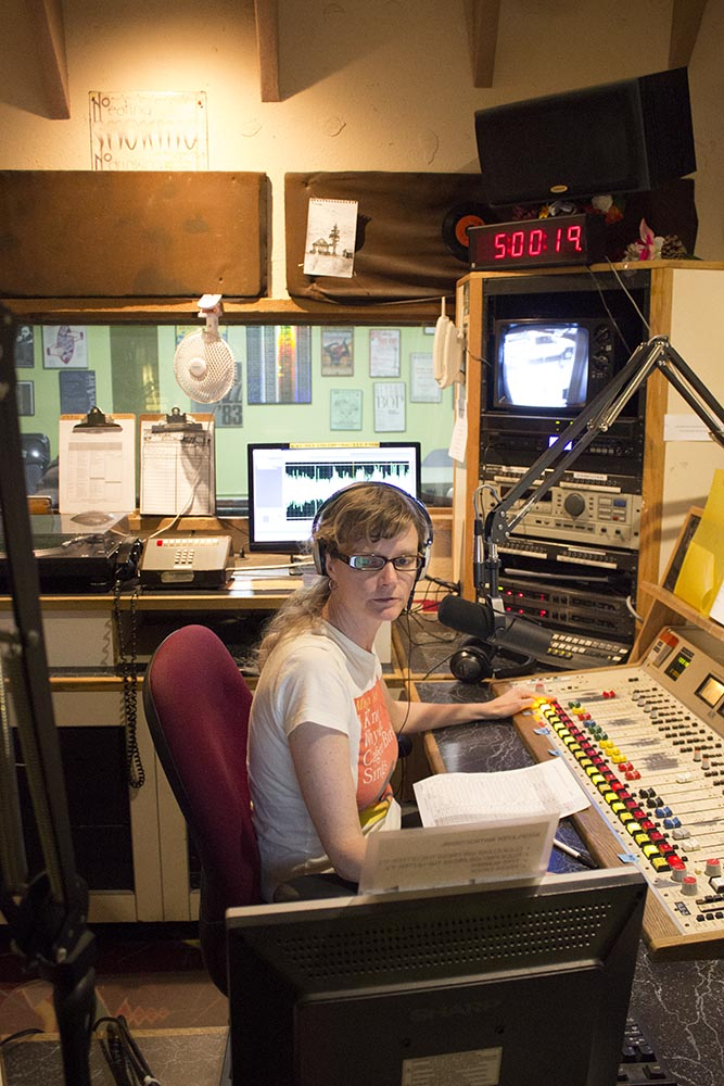 Danielle Parks engineers the KBOO-FM daily newscast. KBOO-FM is a nonprofit community radio station that has been in operation since the 1960s. Photo by Delphine Criscenzo