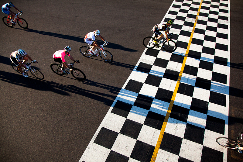 Cyclists race at Portland International Raceway.  Photo by Tim LaBarge