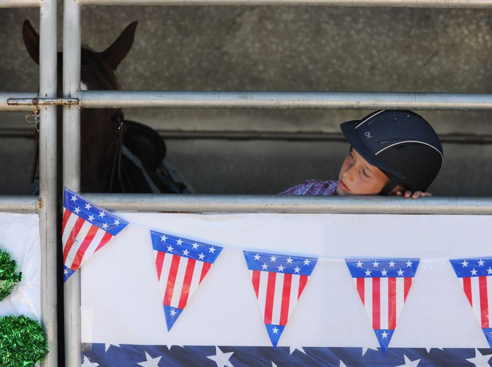 Zoe James, 11, of Sweet Home waits with her 14-year-old Arabian, Blaze, for the start of her event at the Linn County 4H-FFA fair in Albany, Oregon. Photo by Mark Ylen