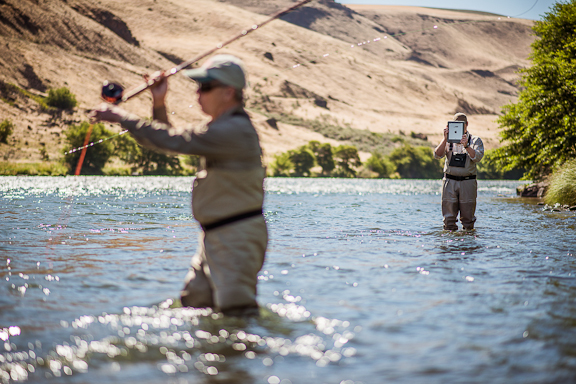 Dan Johnson of Des Moines, WA casts his spey rod while fishing guide, Tom Larimer, records his casting for analysis on an iPad app.  Photo by Craig Strong