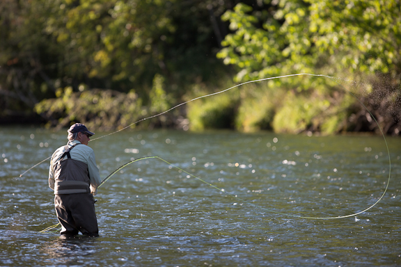 Eugene resident Paul Moore fishes for steelhead on the Willamette River near Dexter on Monday, July 15, 2013. Moore moved to Oregon from California in 1981 and over the years he's spent as much of his free time as possible fly fishing.  Photo by Carl Davaz/The Register-Guard