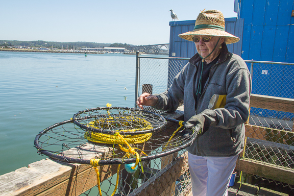 Marlene is the first to admit that crab fishing when it's not crabbing season is a fool's errand, but it is a tradition for her. Every year, the Milwaukie, OR resident comes to Newport for two weeks to go crabbing.  Photo by Meredith Lawrence