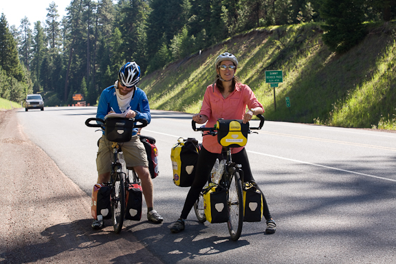 British cyclists Tom Merriman & Jana Phillips take a break at Ochoco Summit - Mile Post 50 on US Hwy 26 - between Mitchell & Prineville. They are in their 10th week of a cross country bike tour from NY to CA.  Photo by Diane Kulpinski