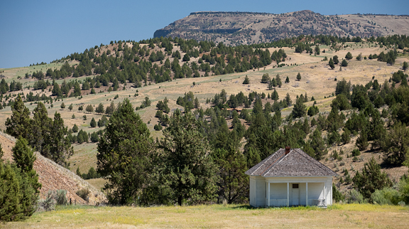 The Waldron School, established in 1874, greets northbound drivers at MP 10 on Hwy 207 between Mitchell & Service Creek. While the school hasn't been used for years, the locals still keep it maintained & welcoming. Photo by Diane Kulpinski