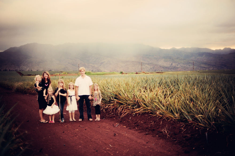 My family in the pineapple fields of the North Shore on Oahu.  I live in this beautiful paradise with my five girls, while my other five babies inhabit the true Paradise...heaven!