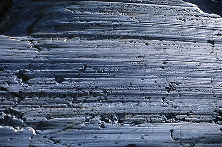 Notice the smooth polished bedrock with the parallel striations
