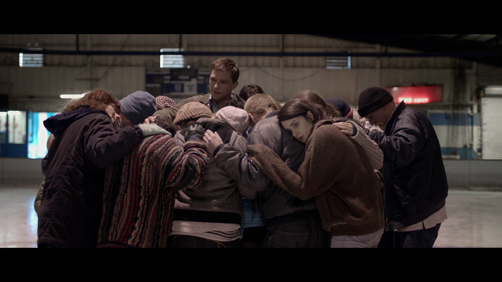 Doug leads them in prayer.png