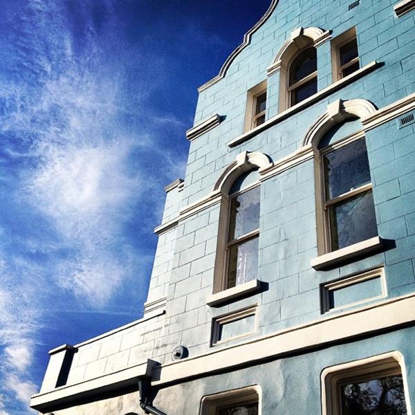 Azure blue sky against a pale blue façade