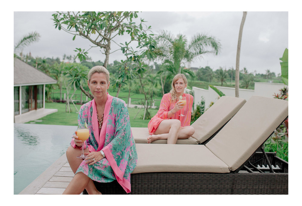 Sandra and Esther relax poolside in our  Lasata Bloom  and  Eleuthera Waves  kimonos