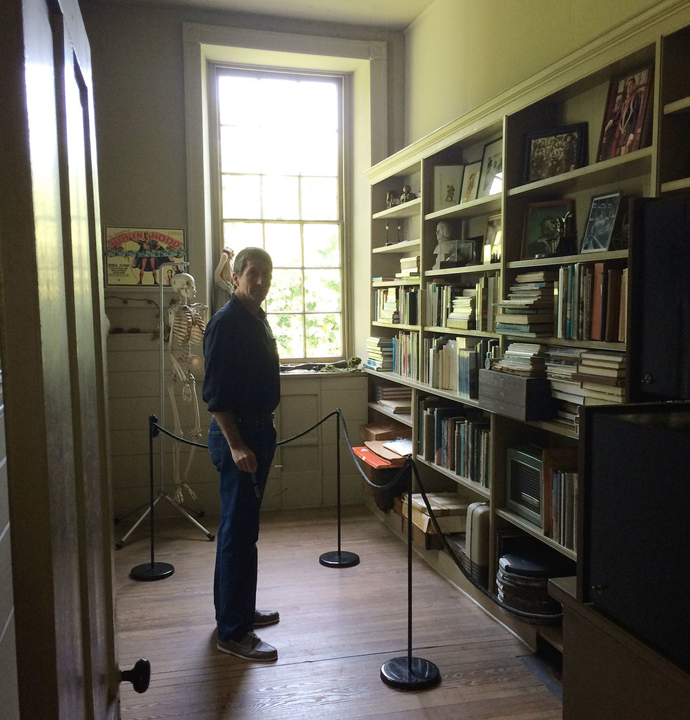 Andrew Wyeth's library room housed books, movie reels, posters, and artifacts that were special to him.