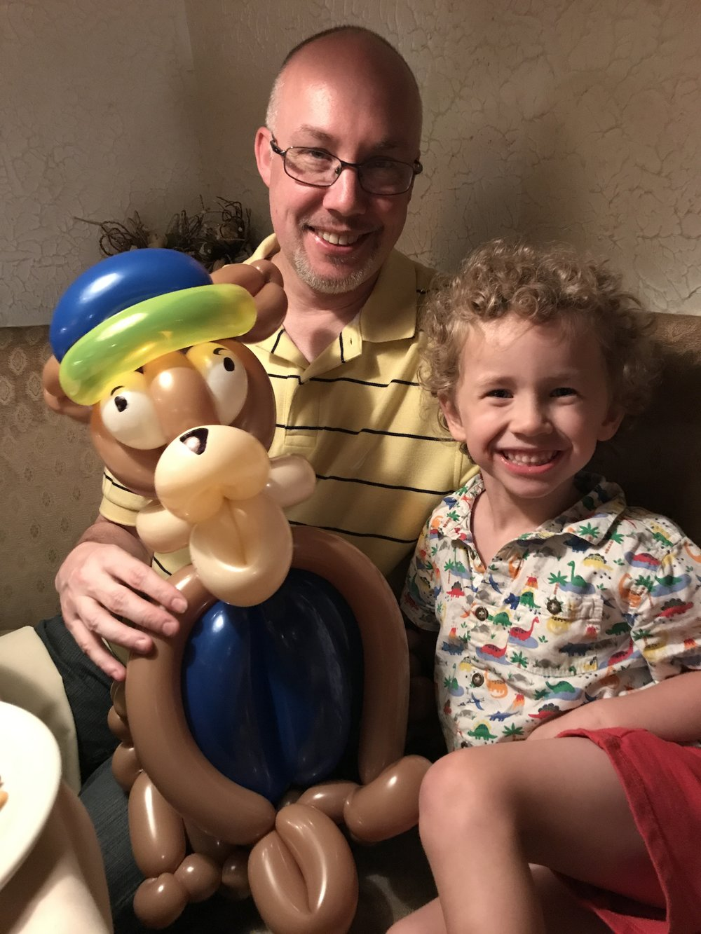 Tucker, Uncle Shawn, and balloon animal Chase from Paw Patrol