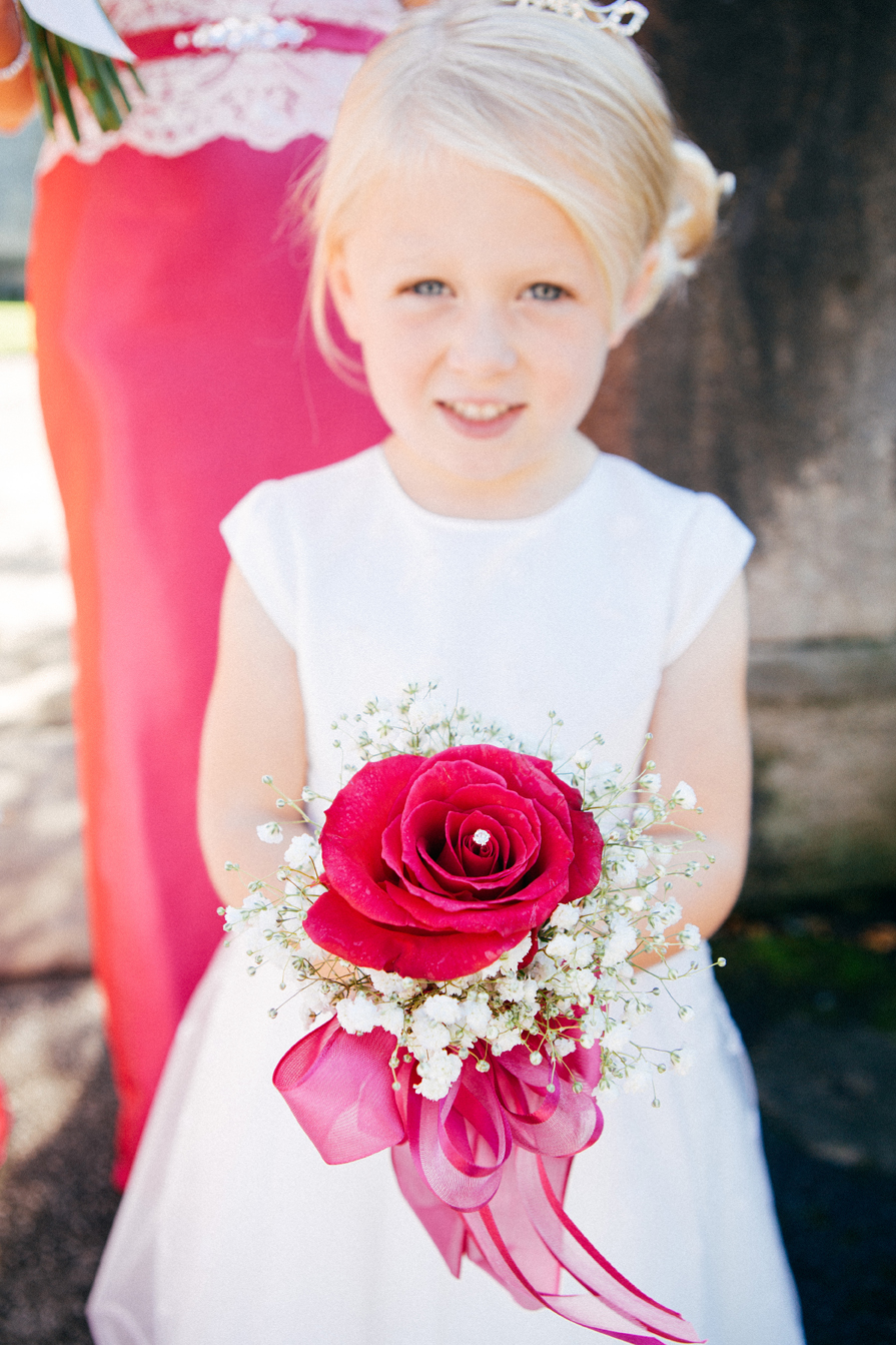 Bridesmaid red rose victoria baker wedding photography leeds