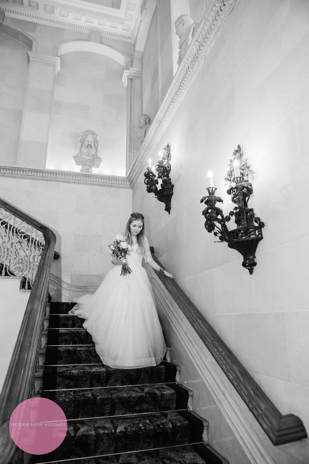 Bride on famous staircase at Oulton Hall Leeds