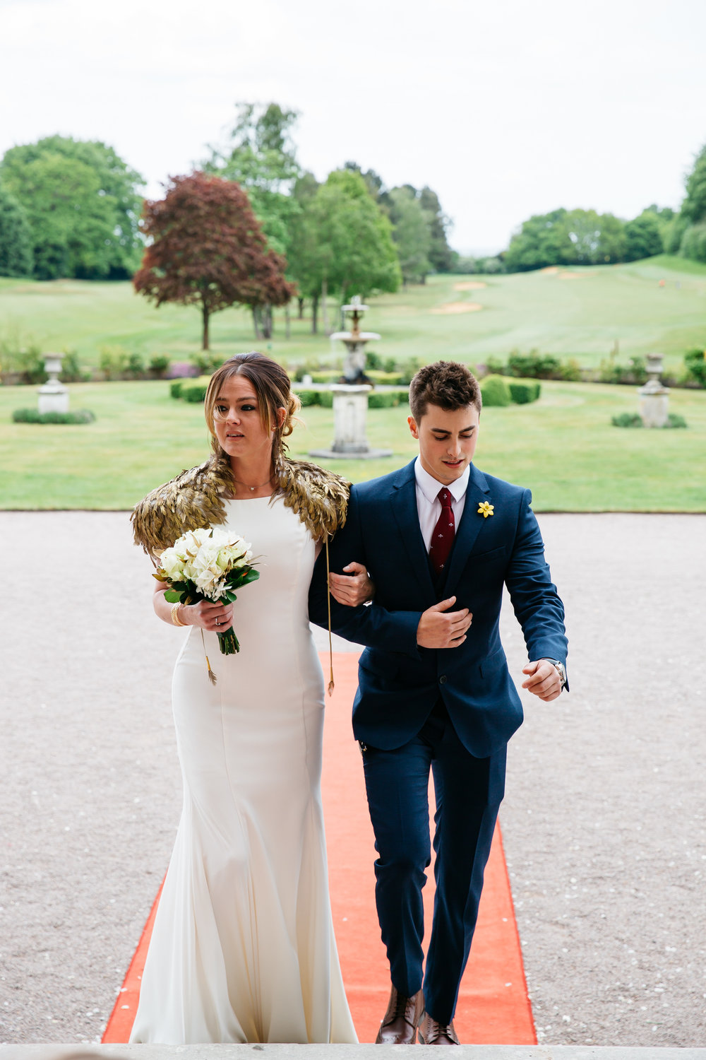 Bride and Brother walking to wedding at Moor Park Rickmansworth