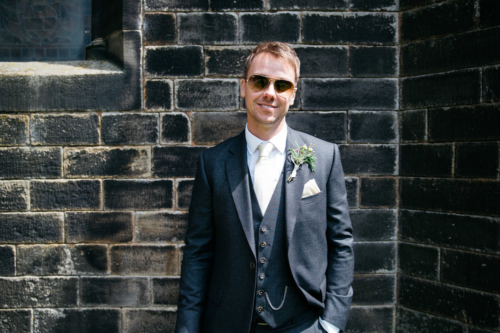Groom in sunglasses at Christ Church in Skipton