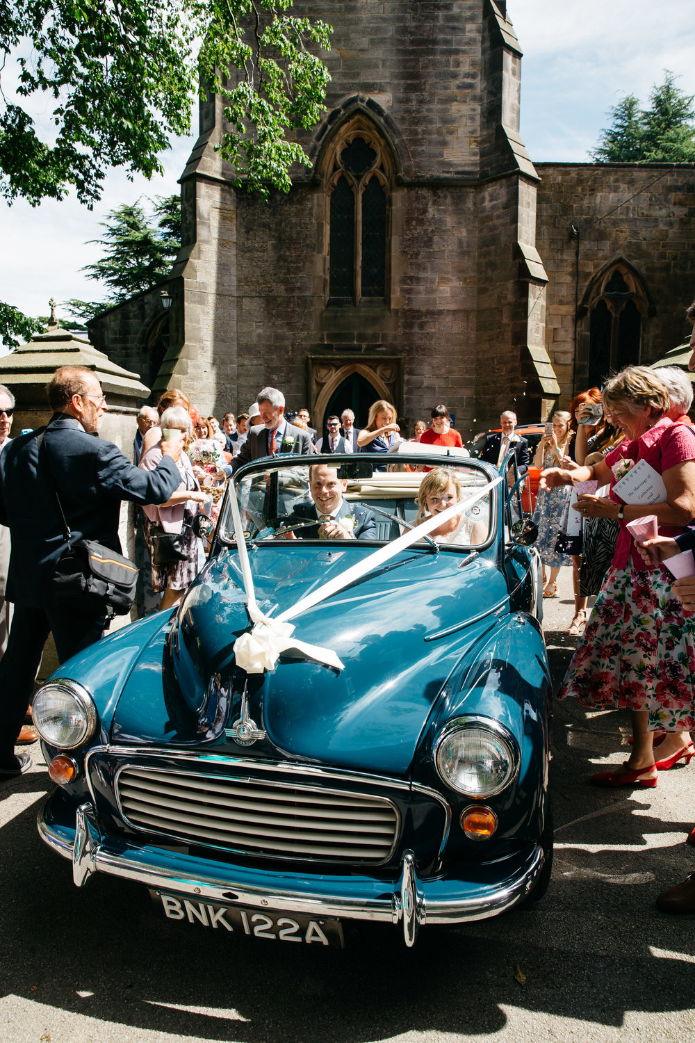 Leaving church in vintage car Wedding Photography North Yorkshire