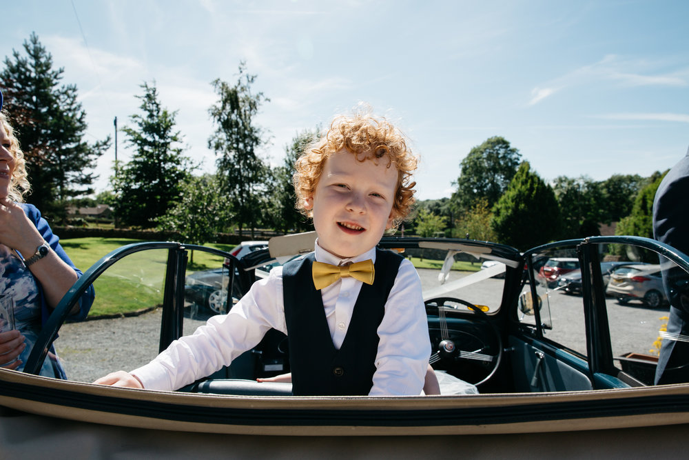 Page Boy in vintage wedding car North Yorkshire