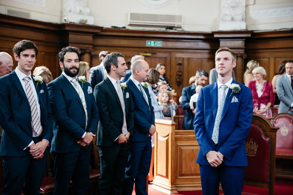 Groom waiting for bride at Islington Town Hall - London Wedding Photographer
