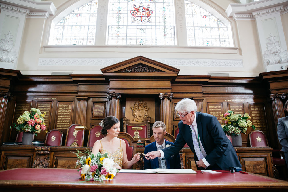 Signing wedding register at Islington Town Hall