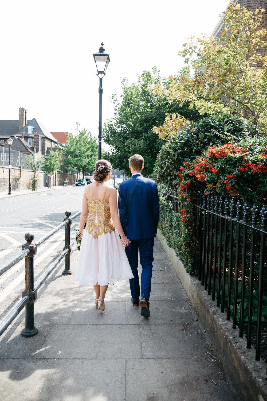 Bride and Groom walking through London
