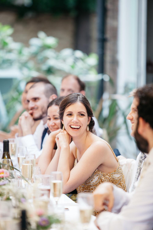 Bride smiling in speeches