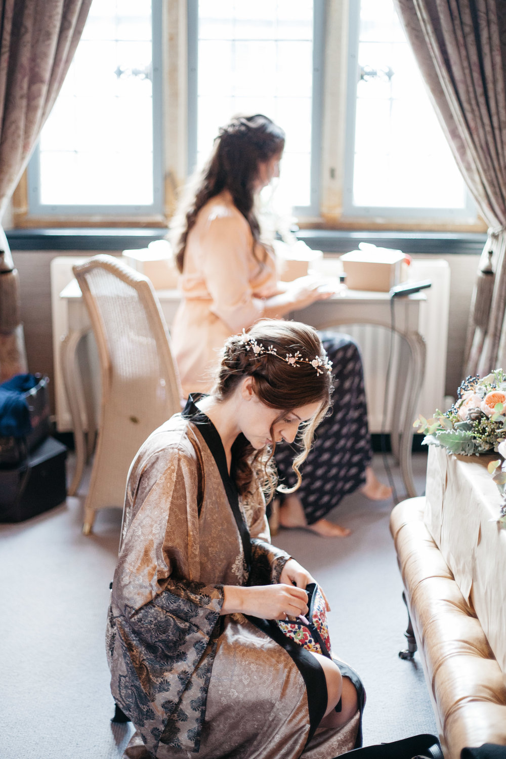 Bride and Bridesmaid getting ready at Falcon Manor Wedding Photography Yorkshire