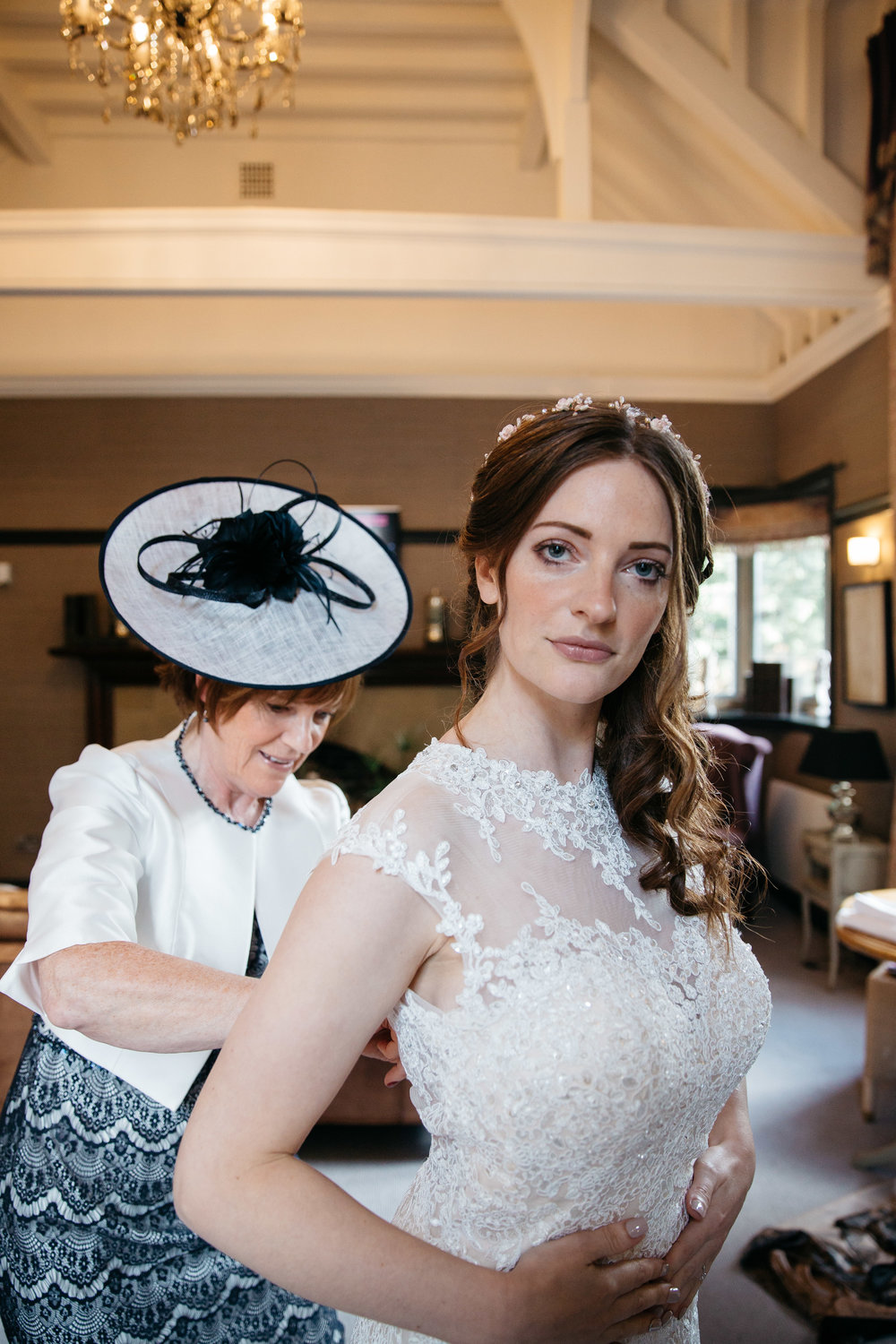 Mother dressing bride at Falcon Manor Wedding Photography Yorkshire