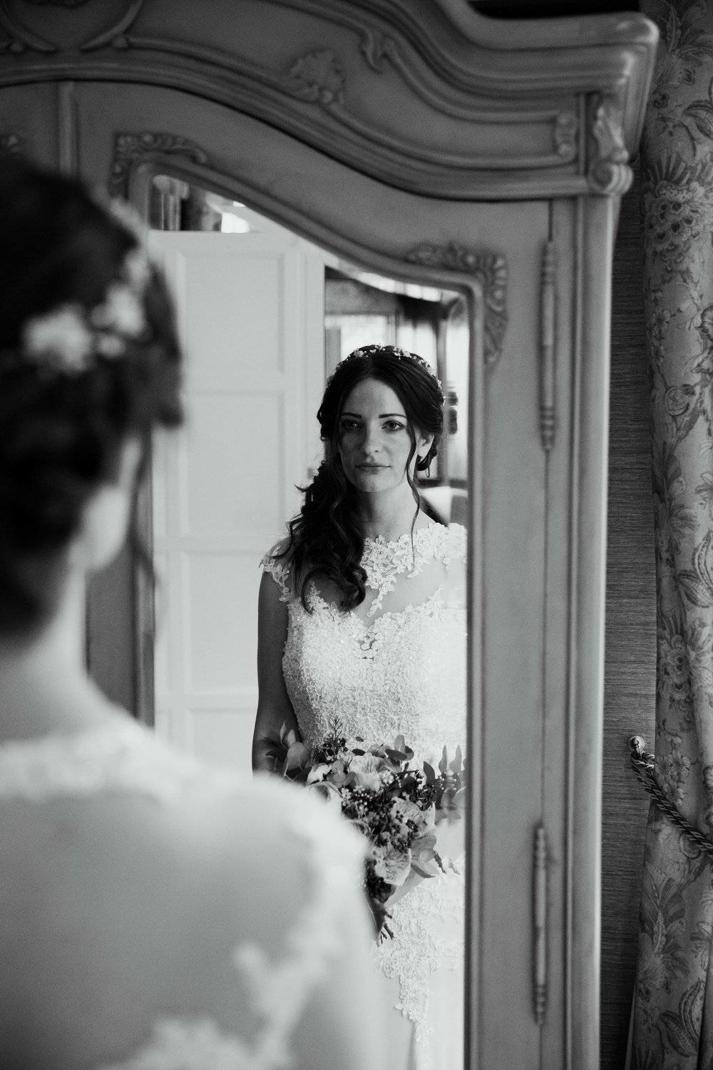Bride reflecting at Falcon Manor Wedding Photography Yorkshire