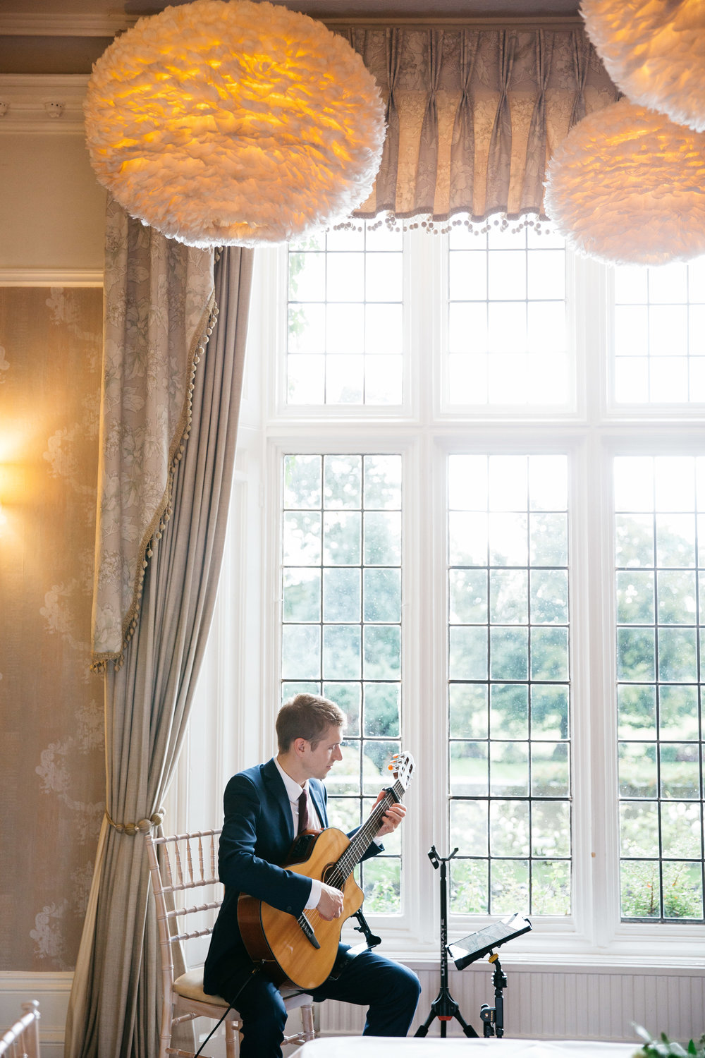 Musician at wedding ceremony at Falcon Manor Wedding Photography Yorkshire