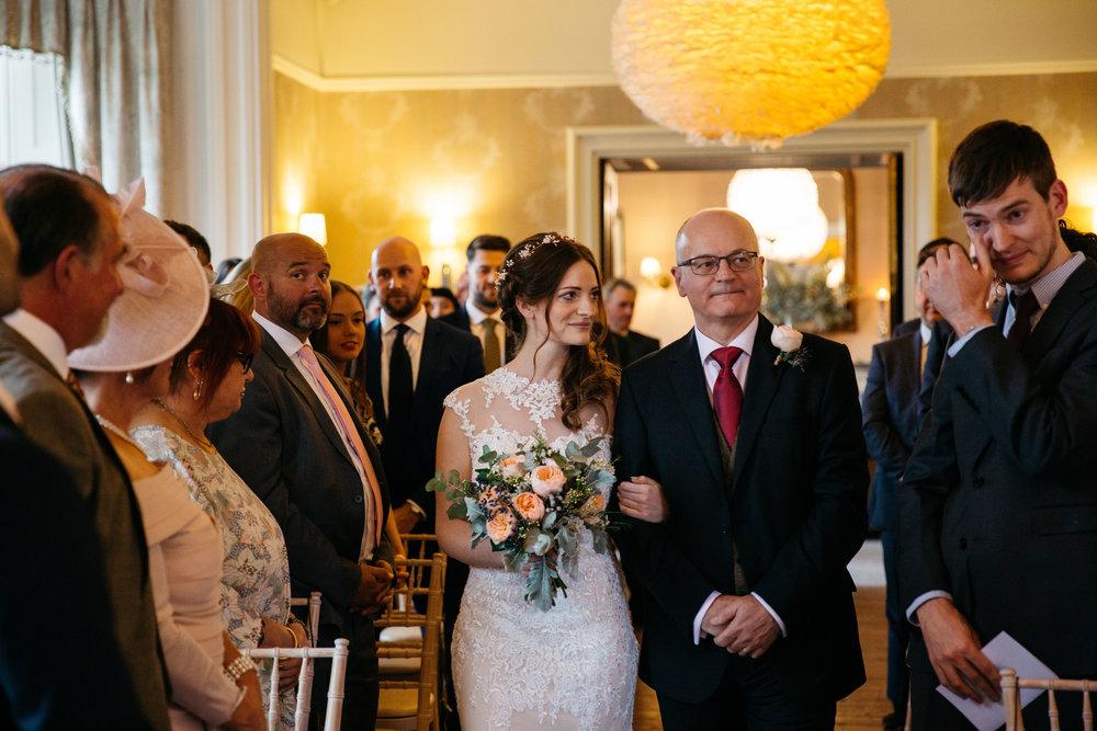 Bride walking down aisle at Falcon Manor Wedding Photography Yorkshire