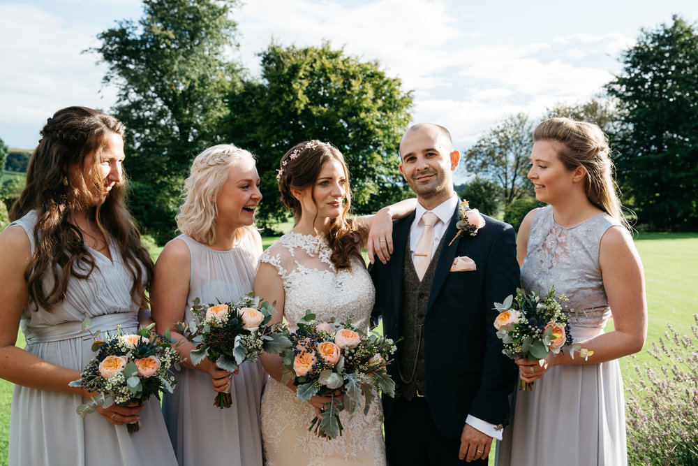 Bride and Groom with bridesmaids at Falcon Manor Wedding Photographer Yorkshire