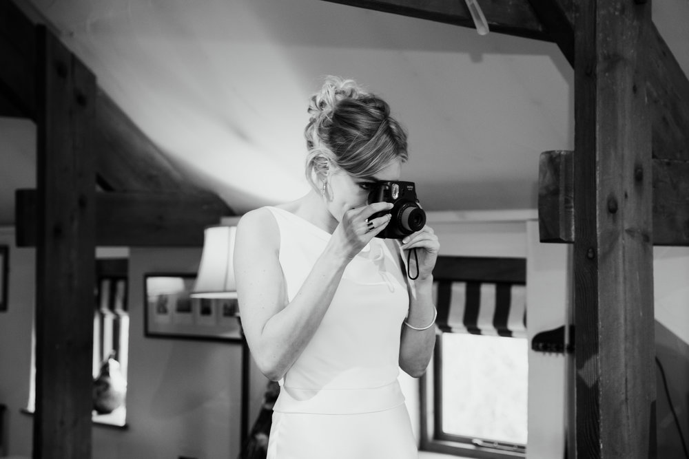 Bride photographer Instax at The Star Inn Harome Yorkshire Wedding Photography