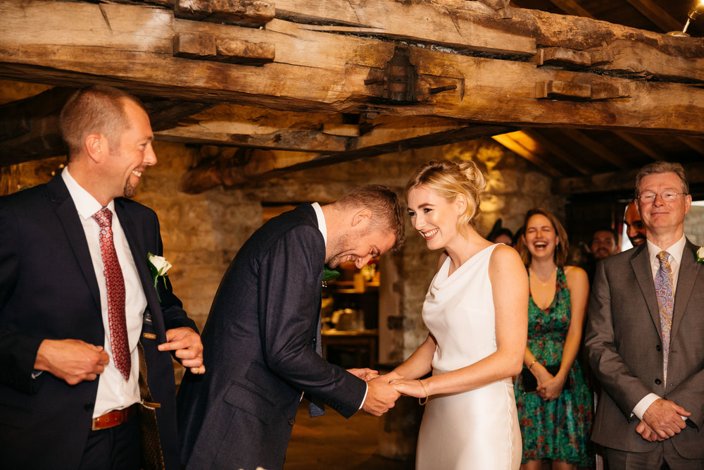 Bride and Groom laughing at The Star Inn Harome Yorkshire Wedding Photography