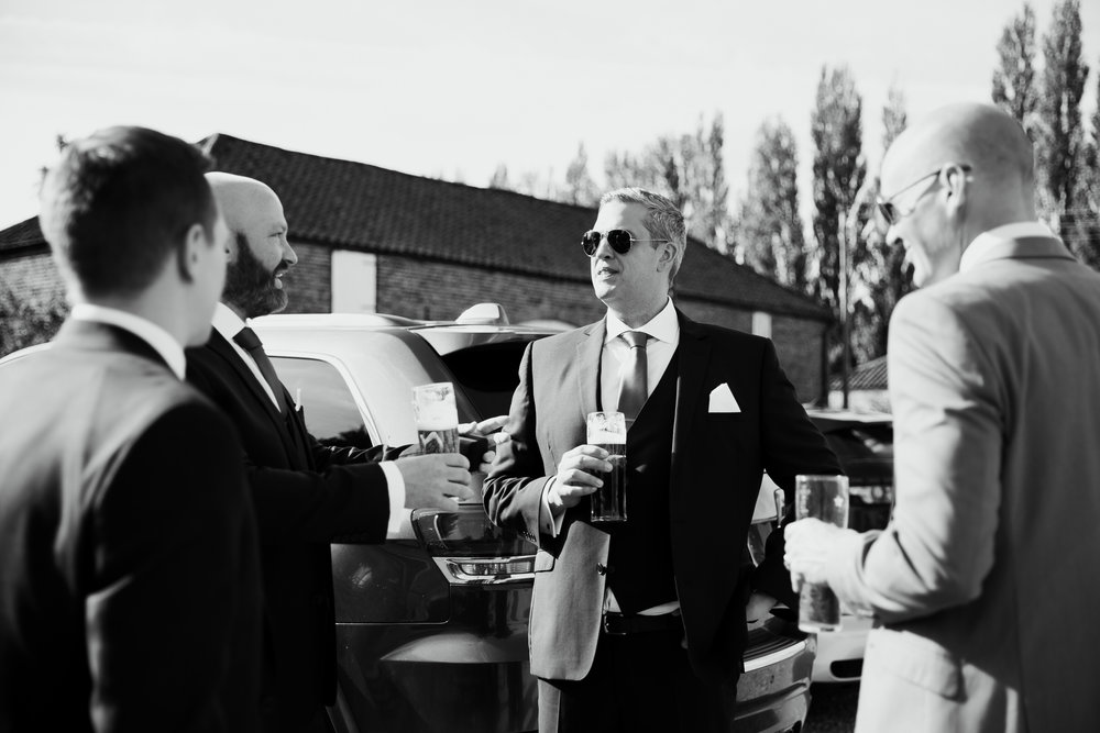Groom and ushers having a beer | Harrogate Wedding Photographer