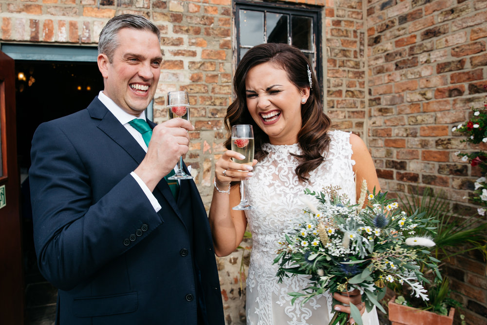 Bride and Groom just married drinking champagne | Harrogate Wedding Photographer