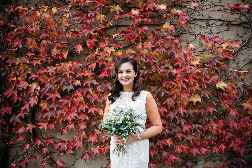 Bride and a wall of red ivy | Harrogate Wedding Photographer