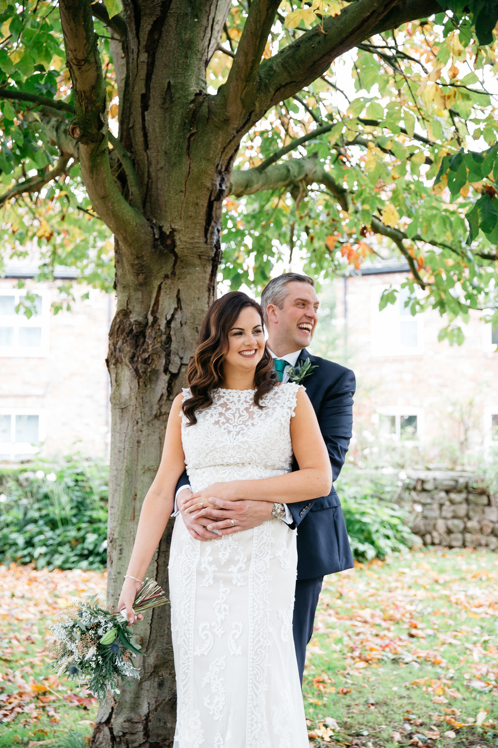 Bride and Groom by a tree | Harrogate Wedding Photographer