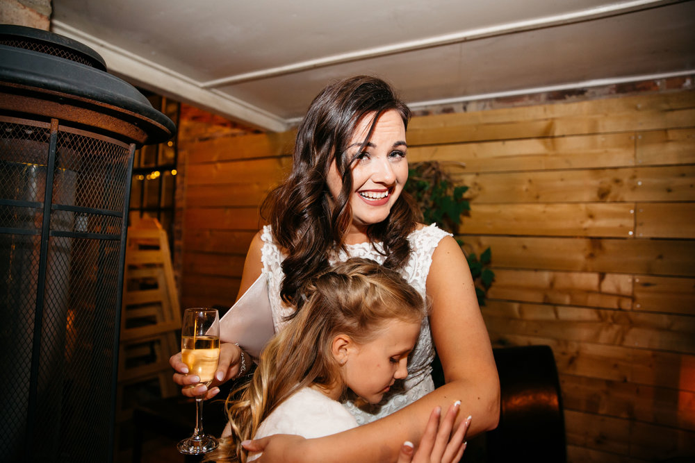 Bride and Flower Girl hugging | Harrogate Wedding Photographer