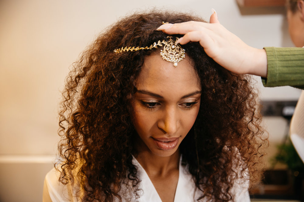 Bride putting on Headpiece | Leeds Creative Wedding Photographer
