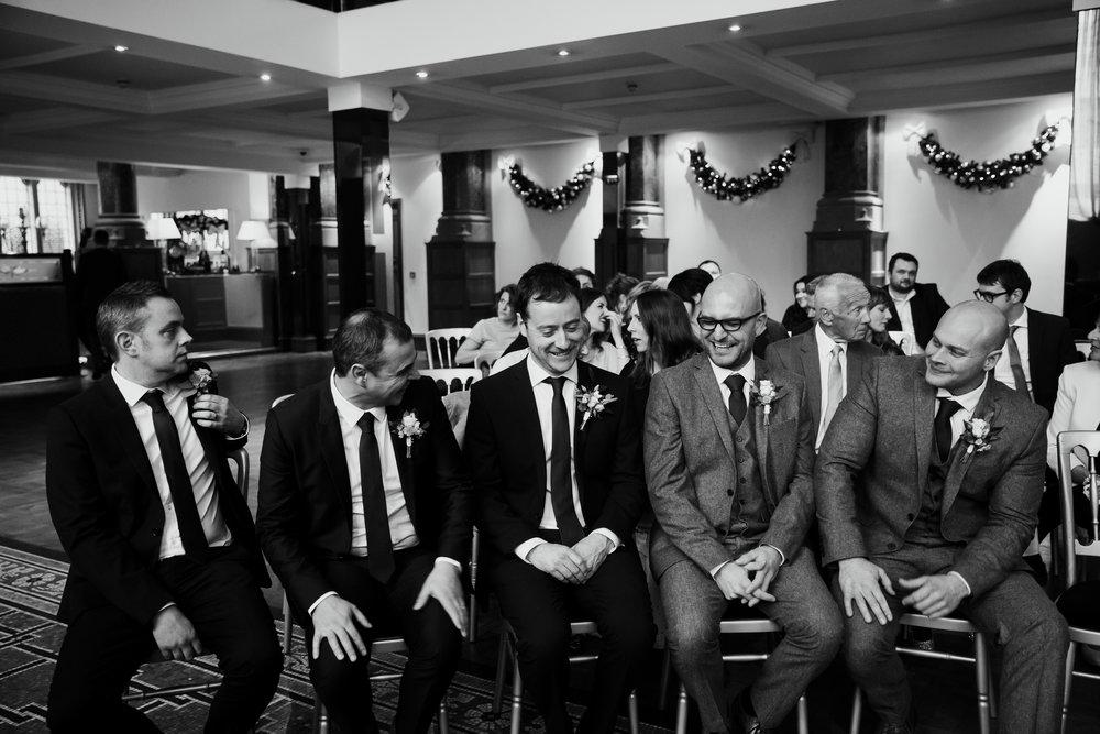 Ushers having a giggle at Aspire Leeds | Leeds wedding Photographer