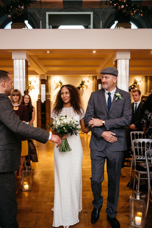 Bride walking down the asile at Aspire | Aspire Leeds wedding Photographer