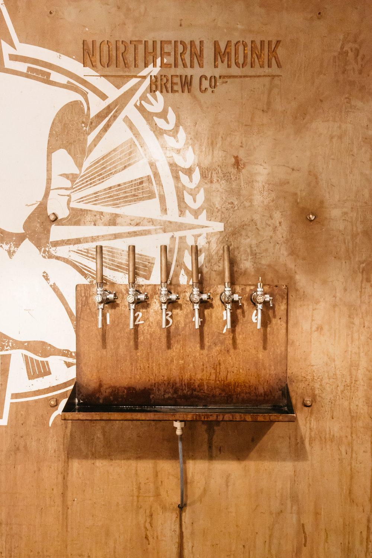 Northern Monk Brewery Wedding Reception, beer taps | Wedding Photographer Leeds