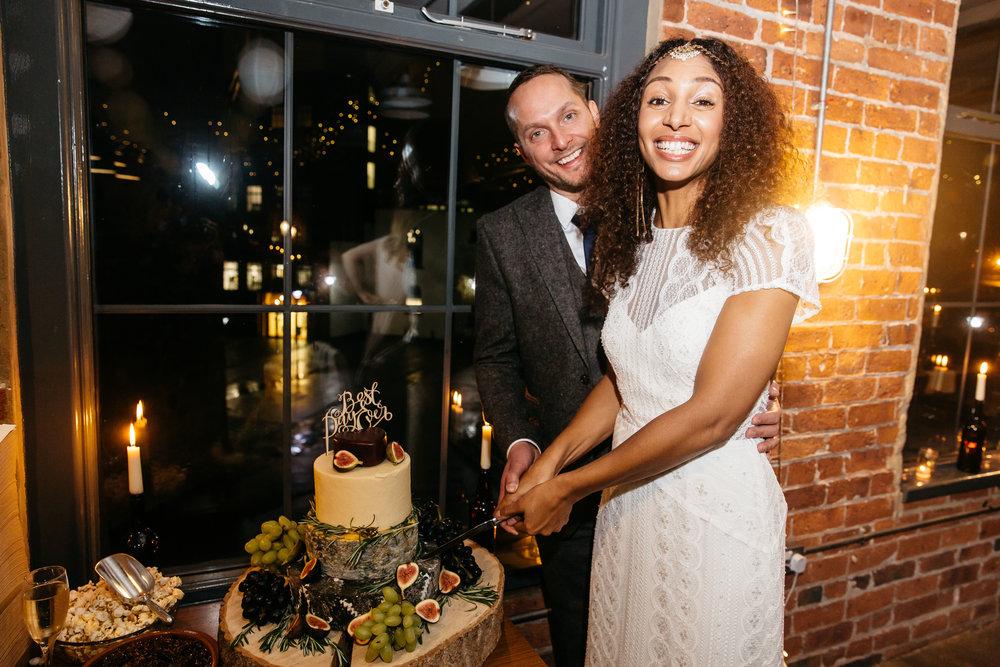 Cutting cheese wedding cake | Wedding Photographer Leeds