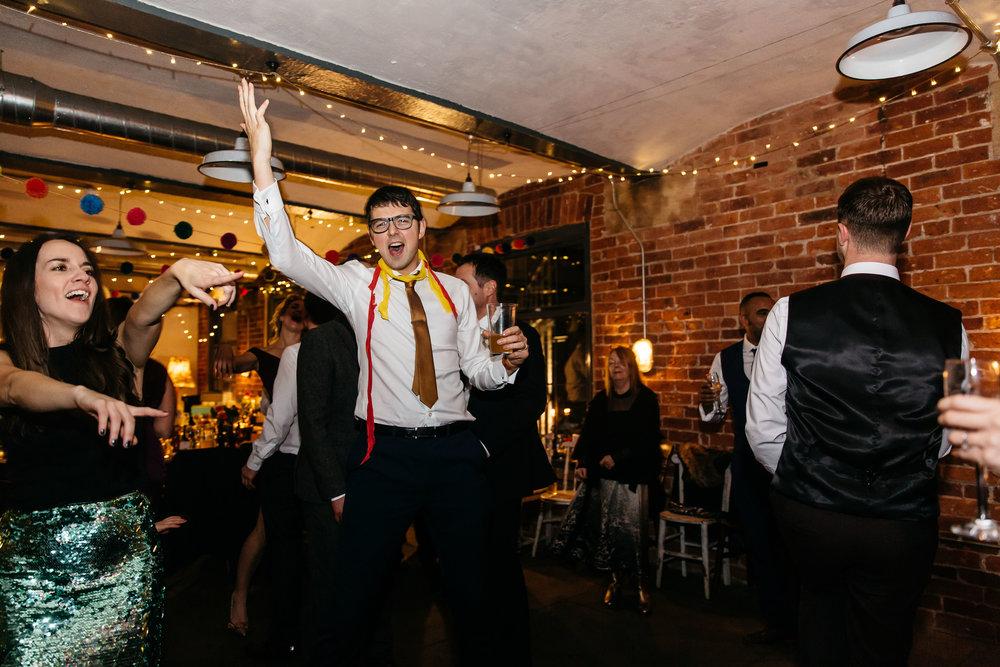 Wedding guests dancing at Northern Monk Brewery | Wedding Photographer Leeds