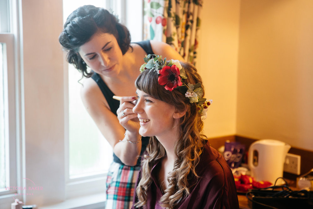Bride getting make up done at Monk Fryston Hall | Wedding photographer Leeds