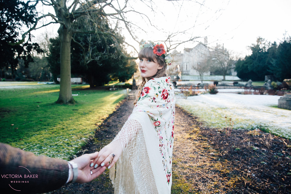 Bride leading Groom by hand at Monk Fryston Hall Leeds Wedding Photographer